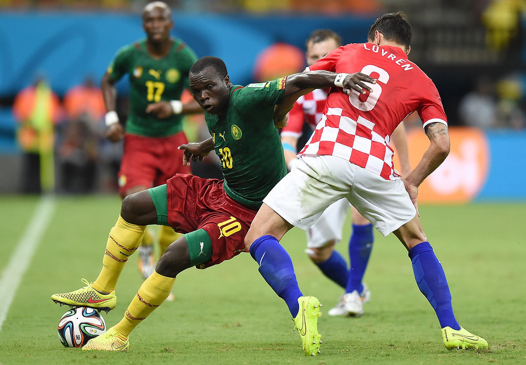 . Croatia\'s defender Dejan Lovren (R) challenges Cameroon\'s forward Vincent Aboubakar for the ball during the Group A football match between Cameroon and Croatia at The Amazonia Arena in Manaus on June 18, 2014, during the 2014 FIFA World Cup. JAVIER SORIANO/AFP/Getty Images