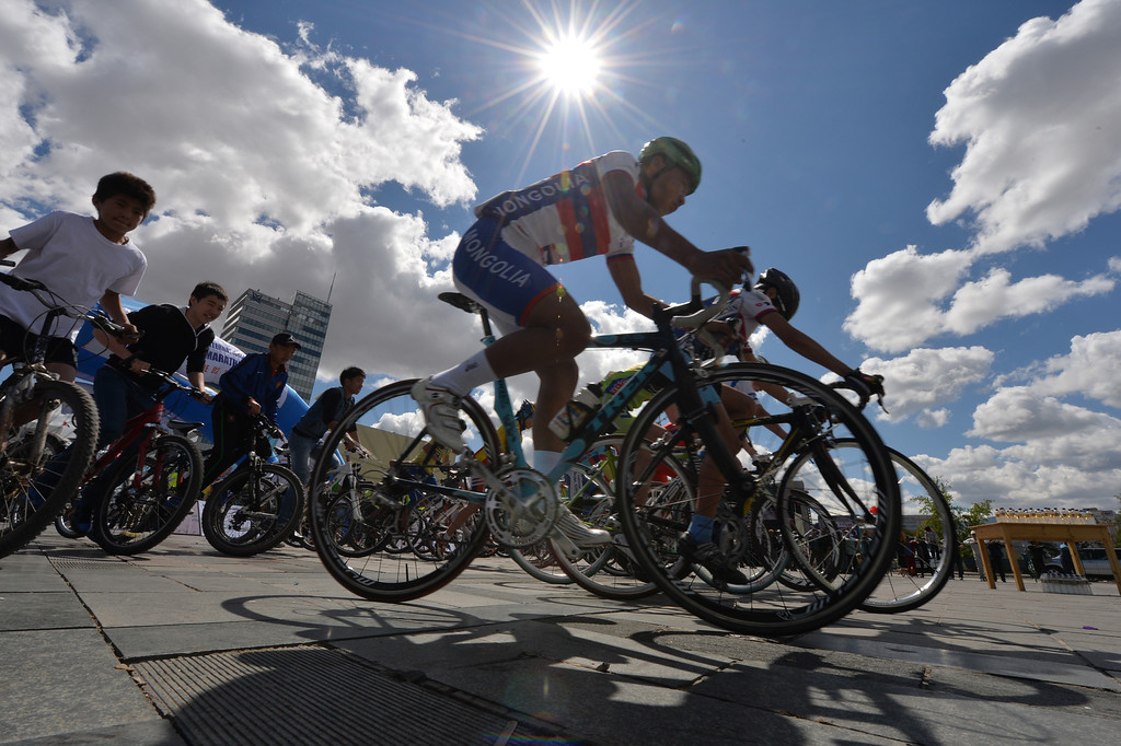 . Cyclists race during events to promote a No-Car day in Ulan Bator, Mongolia on June 2, 2013.  The race is held to promote World Environment Day which falls on June 5th. MARK RALSTON/AFP/Getty Images
