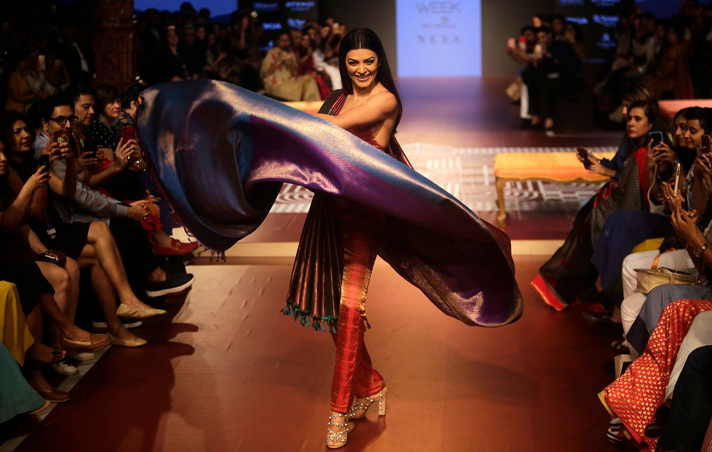 . Bollywood actress Sushmita Sen walks the ramp to showcase the creation of designer Sunita Shanker during Lakme fashion week winter 2018 in Mumbai, India, Thursday, Aug. 23, 2018. (AP Photo/Rajanish Kakade)