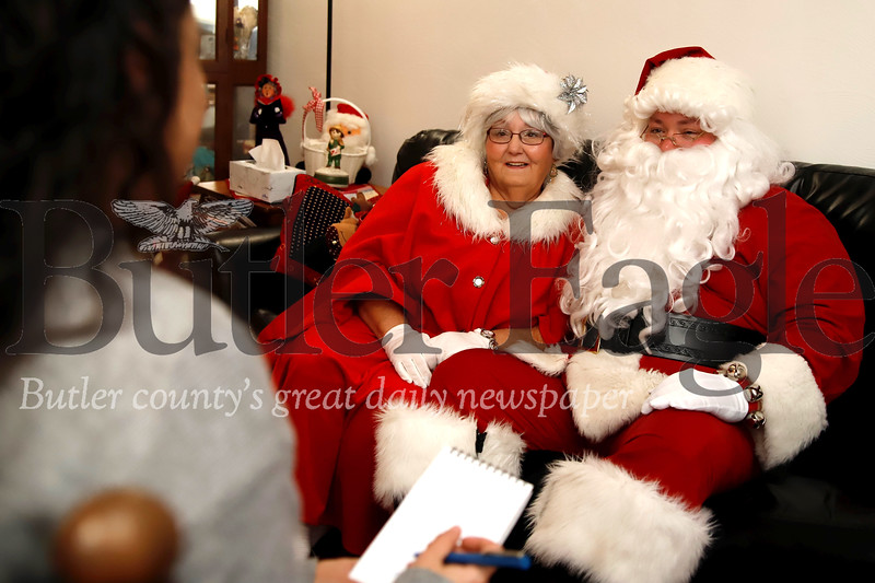 Clad in their Santa and Mrs. Claus garb, Glen Gitzen and his mother Becky sit for an interview prior to an appearance. Seb Foltz/Butler Eagle
