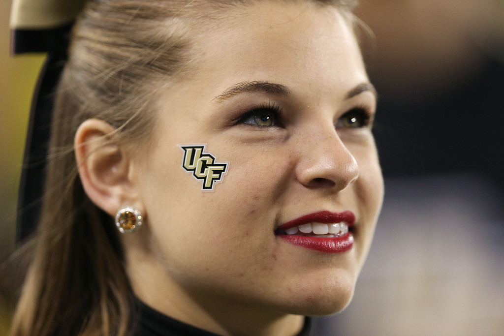 . GLENDALE, AZ - JANUARY 01:  A UCF Knights cheerleader looks on prior to their game against the Baylor Bears in the Tostitos Fiesta Bowl at University of Phoenix Stadium on January 1, 2014 in Glendale, Arizona.  (Photo by Christian Petersen/Getty Images)