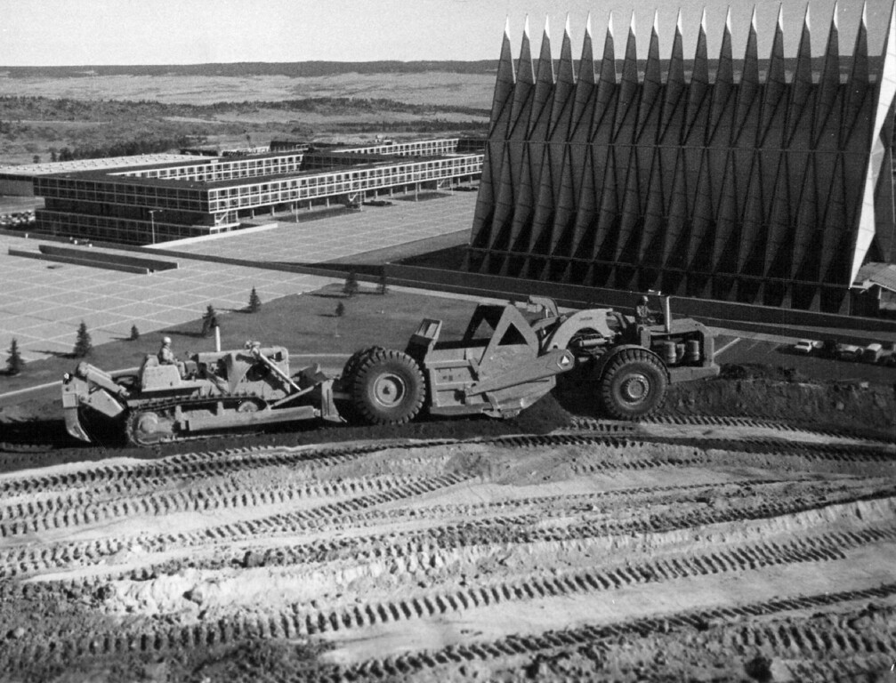 . Heavy Equipment Moves Dirt To Location For Second Cadet Quarters Increment At The Air Force Academy. Construction was keynote at the academy during 1966 as work on three expansion programs got under way. 1967. The Denver Post Library Archive