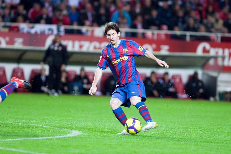 Messi shooting onto goal. Spanish Cup game between Sevilla FC and FC Barcelona, Ramon Sanchez Pizjuan stadium, Seville, Spain, 13 January 2010