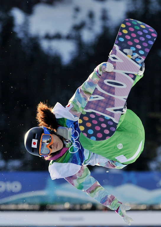 . Soko Yamaoko of Japan compete in the women\'s snowboard halfpipe at the Vancouver 2010 Olympics in Vancouver, British Columbia, Thursday, Feb. 18, 2010. (AP Photo/Bela Szandelszky)