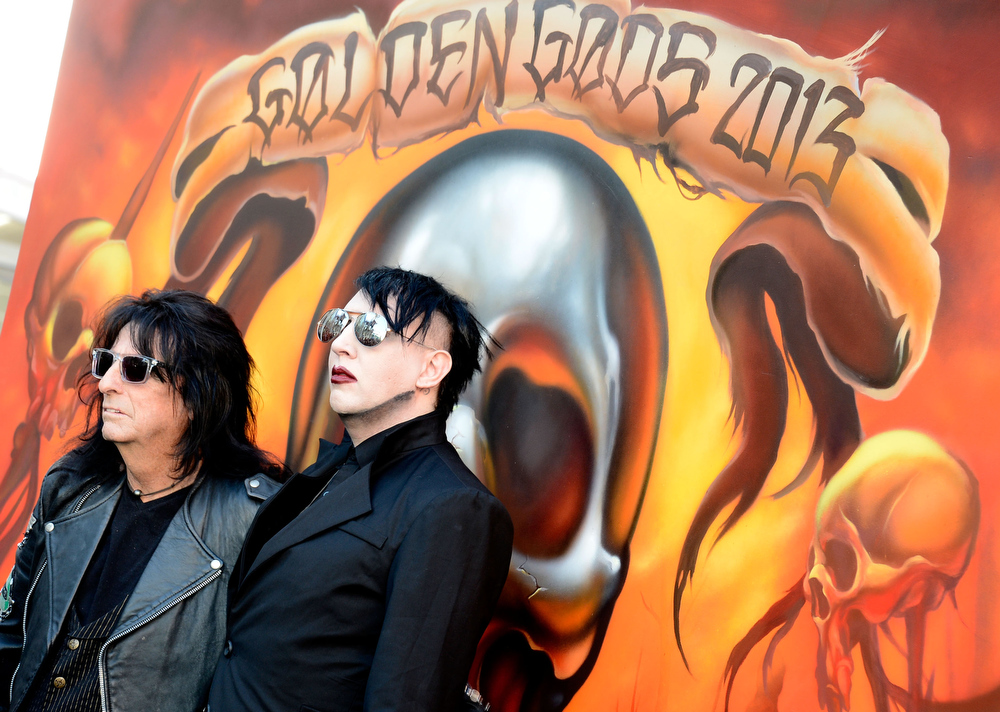 . Musicians Alice Cooper and Marilyn Manson arrive at the 5th Annual Revolver Golden Gods Award Show  at Club Nokia on May 2, 2013 in Los Angeles, California.  (Photo by Frazer Harrison/Getty Images)