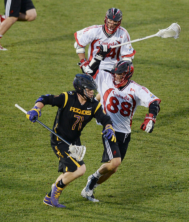 . COMMERCE CITY, CO - JULY 17: Canada attack Zach Greer (88) took a hack at Iroquois defender Oakley Thomas (71) after Canada lost the ball on offense in the second quarter.  The Iroquois Nationals took on Canada in a FIL World Championship semifinal game Thursday night, July 17, 2014.  Photo by Karl Gehring/The Denver Post