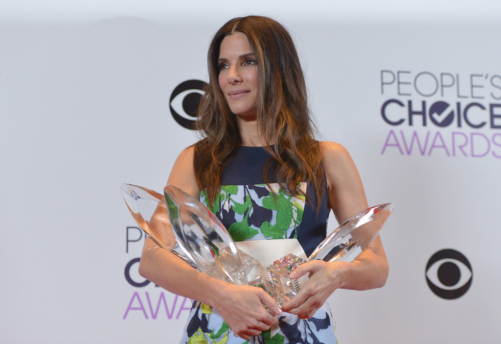 . Sandra Bullock, winner of the Favorite Movie Actress, Favorite Dramatic Movie Actress and Favorite Comedic Movie Actress poses in the press room at the 40th annual People\'s Choice Awards at Nokia Theatre L.A. Live on Wednesday, Jan. 8, 2014, in Los Angeles. (Photo by John Shearer/Invision/AP)
