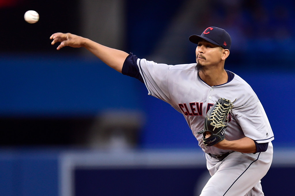 . Cleveland Indians starting pitcher Carlos Carrasco (59) throws to a Toronto Blue Jays batter during the first inning of a baseball game Friday, Sept. 7, 2018, in Toronto. (Frank Gunn/The Canadian Press via AP)