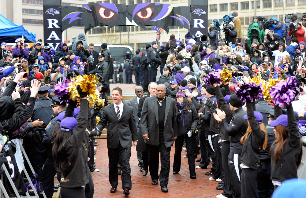 . Baltimore Ravens head coach John Harbaugh, left, and general manager Ozzie Newsome arrive at a send-off rally on Monday, Jan. 28, 2013 in Baltimore. The NFL football team is leaving for New Orleans to face the San Francisco 49ers in the Super Bowl. (AP Photo/Steve Ruark)
