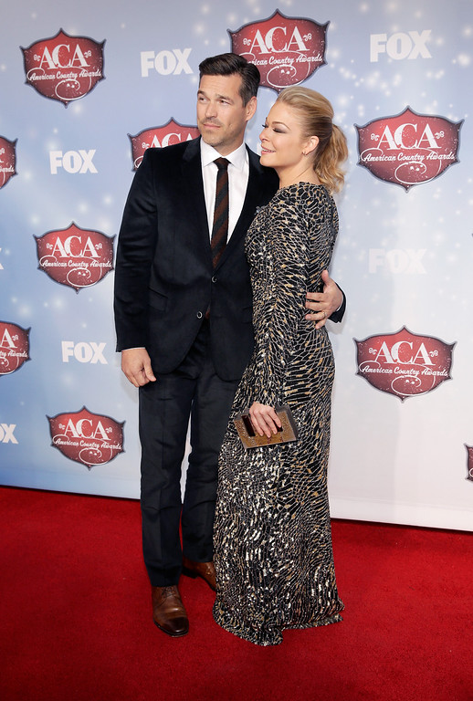 . Recording artist LeAnn Rimes (R) and actor Eddie Cibrian arrive at the 2013 American Country Awards at the Mandalay Bay Events Center on December 10, 2013 in Las Vegas, Nevada.  (Photo by Isaac Brekken/Getty Images)