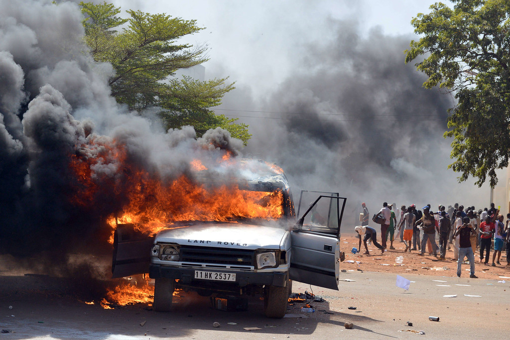 . Cars and documents burn outside the parliament in Ouagadougou on October 30, 2014. ISSOUF SANOGO/AFP/Getty Images