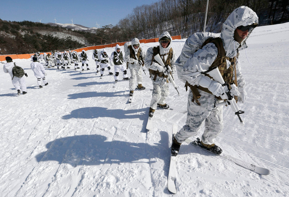 Description of . South Korean Marines and U.S. counterparts from 3-Marine Expeditionary Force 1st Battalion from Kaneho Bay, Hawaii, ski on a snow field during their Feb. 4-22 joint military winter exercise in Pyeongchang, east of Seoul, South Korea, Thursday, Feb. 7, 2013. More than 400 marines from the two countries participated in the joint winter exercise held for the first time in South Korea. (AP Photo/Lee Jin-man)