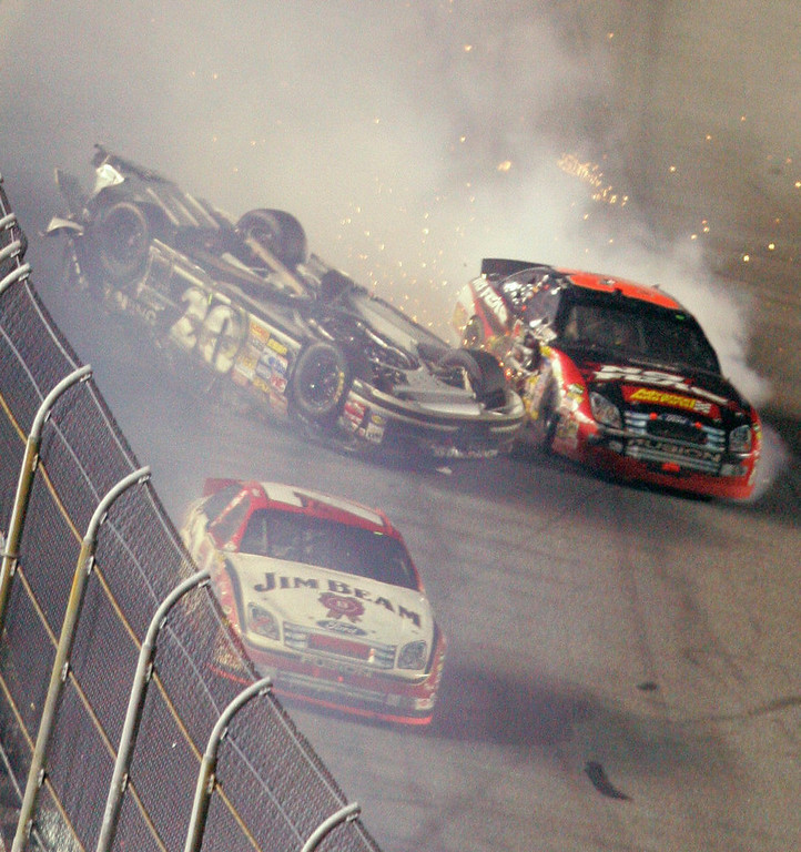 . Clint Bowyer slides upside down following a crash on the final lap of the NASCAR Daytona 500 auto race at Daytona International Speedway in Daytona Beach, Fla., Sunday, Feb. 18, 2007. Robby Gordon is at front. (AP Photo/David Graham)