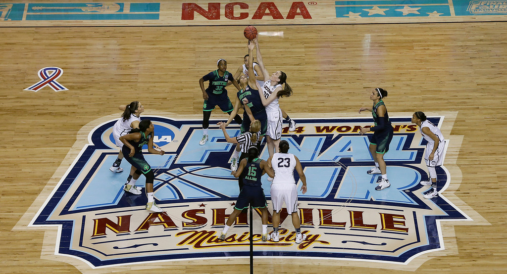. Connecticut forward Breanna Stewart (30) and Notre Dame forward Taya Reimer (12) tip the ball off during the first half of the championship game in the Final Four of the NCAA women\'s college basketball tournament, Tuesday, April 8, 2014, in Nashville, Tenn. (AP Photo/Mark Humphrey)