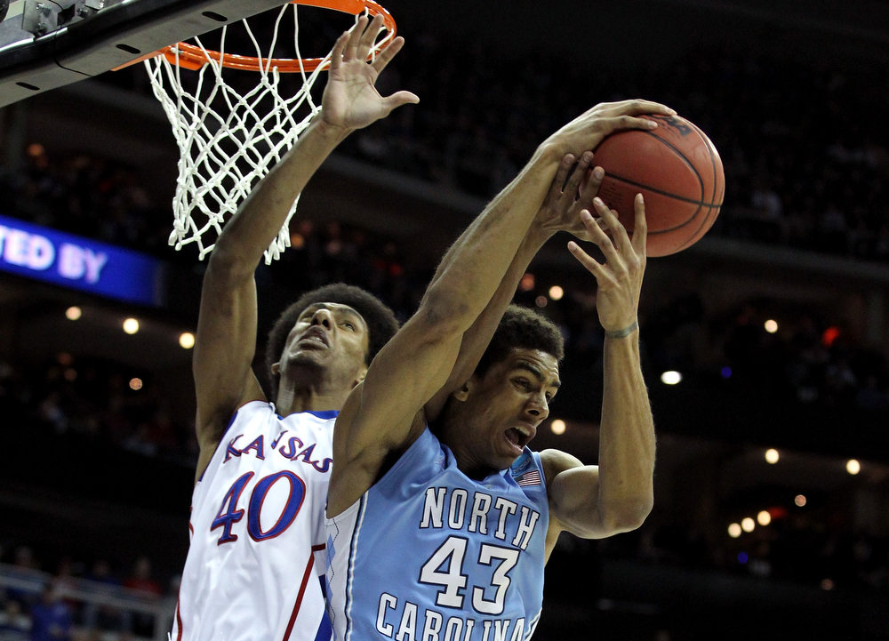 . Kevin Young #40 of the Kansas Jayhawks fights for a rebound against James Michael McAdoo #43 of the North Carolina Tar Heels in the first half during the third round of the 2013 NCAA Men\'s Basketball Tournament at Sprint Center on March 24, 2013 in Kansas City, Missouri.  (Photo by Ed Zurga/Getty Images)