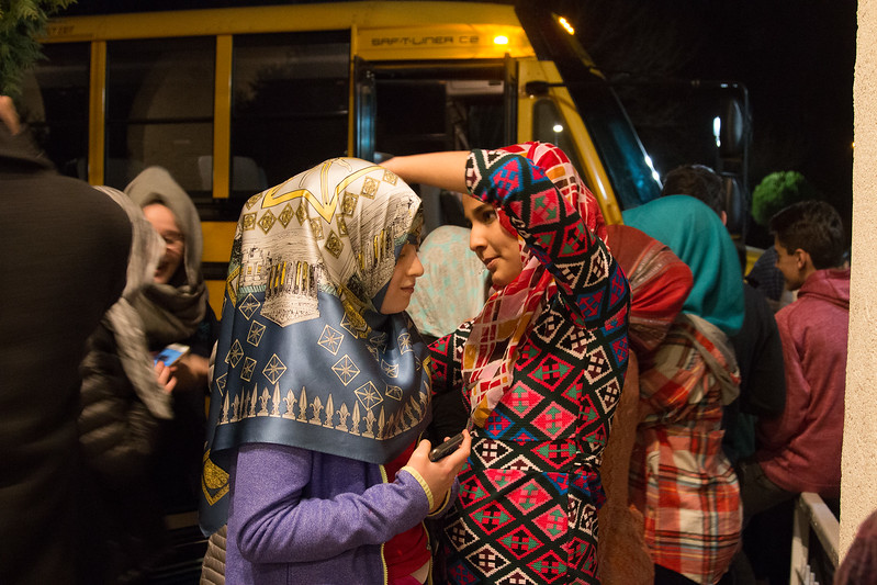 Outside, the Muslim girls help the Beth El girls with their headscarves -- Beth El 8th grade Upper School students visited the Islamic Center mosque in Rockville, Feb 21, 2017