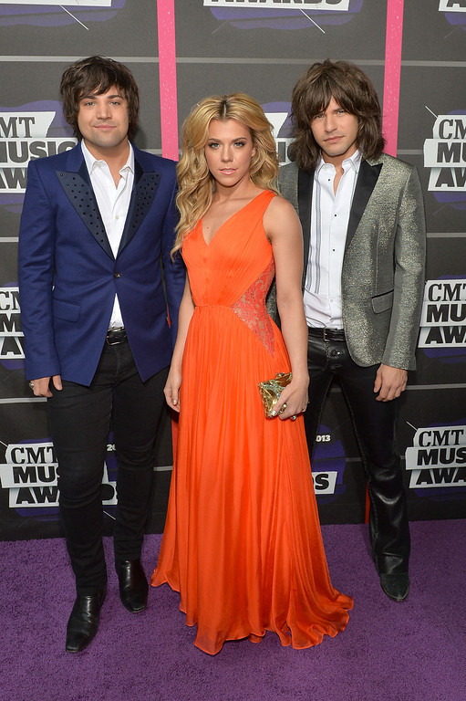 . NASHVILLE, TN - JUNE 05:  (L-R) Musicians Neil Perry, Kimberly Perry and Reid Perry of The Band Perry attend the 2013 CMT Music awards at the Bridgestone Arena on June 5, 2013 in Nashville, Tennessee.  (Photo by Rick Diamond/Getty Images)