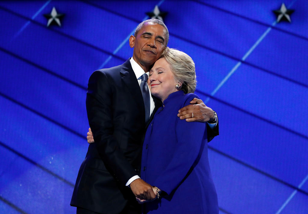 . President Barack Obama hugs Democratic Presidential candidate Hillary Clinton after addressing the delegates during the third day session of the Democratic National Convention in Philadelphia, Wednesday, July 27, 2016. (AP Photo/Carolyn Kaster)