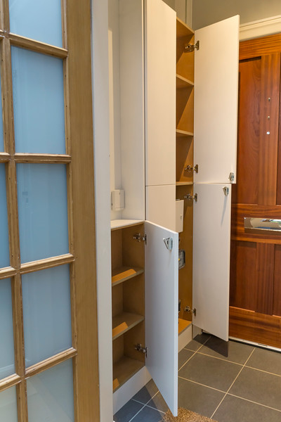 Narrow vestibule storage for shoes, jackets and to cover electric meters