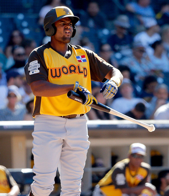 . World Team\'s Jorge Bonifacio, of the Kansas City Royals, this against the U.S. Team during the third inning of the All-Star Futures baseball game, Sunday, July 10, 2016, in San Diego. (AP Photo/Lenny Ignelzi)