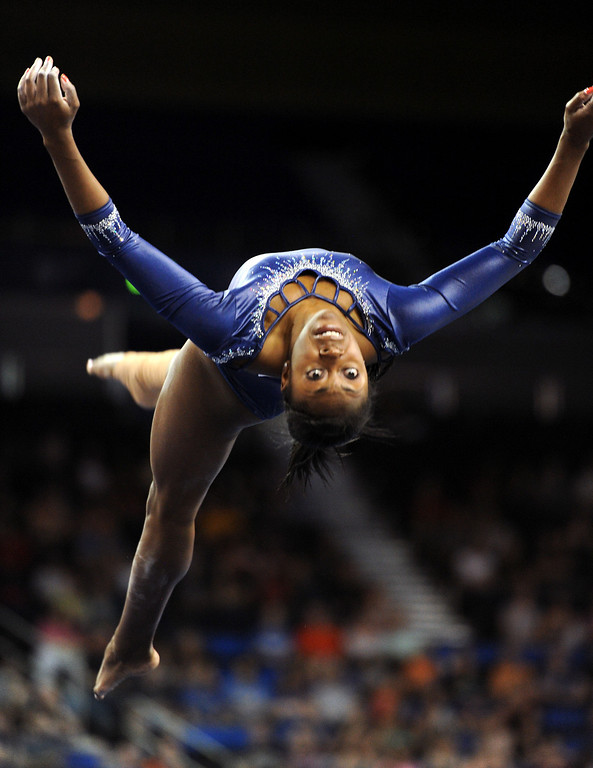 . UCLA\'s Olivia Courtney competes on the floor exercise at the NCAA Women\'s Gymnastics Championship Team Finals at Pauley Pavilion, Saturday, April 20, 2013. (Michael Owen Baker/Staff Photographer)