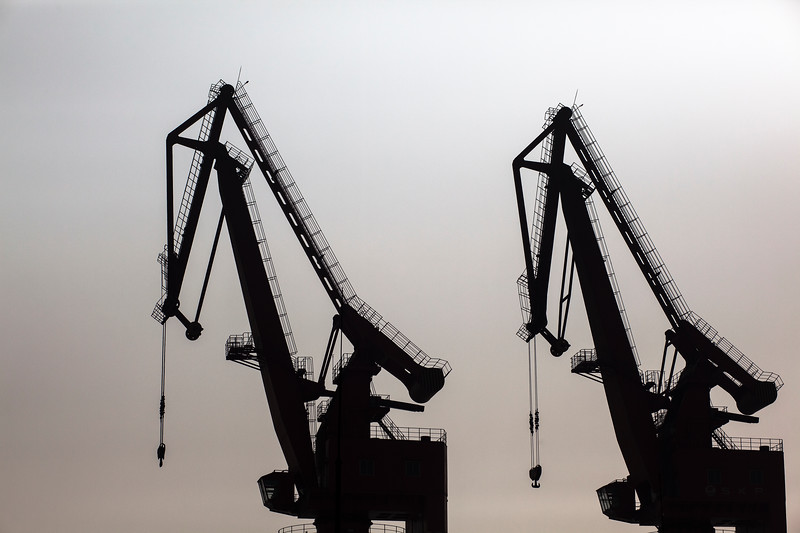 Cranes stand idle at the Port of Shekou in Shenzhen, Guangdong Province, China on Saturday, Jan. 8, 2011.  Photographer: Forbes Conrad/Bloomberg News