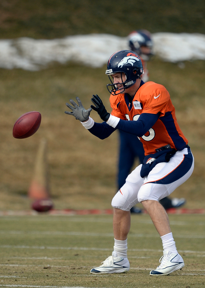 . Denver Broncos quarterback Peyton Manning (18) takes the snap during practice January 15, 2014 at Dove Valley. The Broncos are preparing for their game against the New England Patriots in the AFC championship game.  (Photo by John Leyba/The Denver Post)