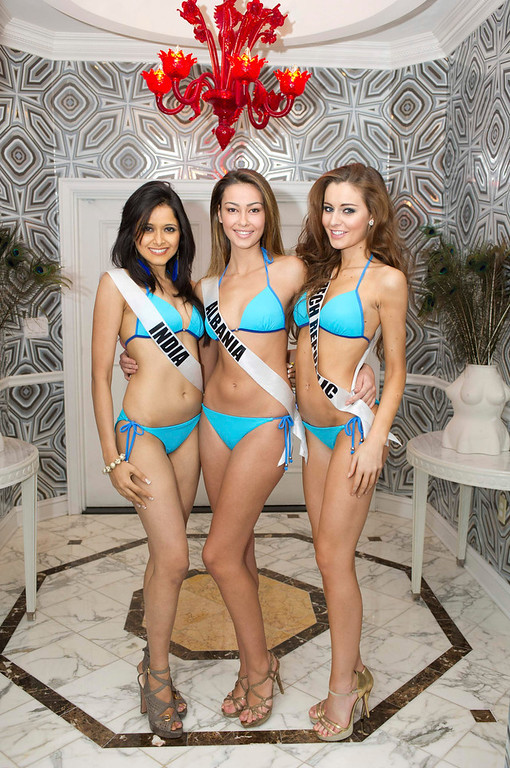 . Miss India Shilpa Singh (L-R), Miss Albania Adrola Dushi, and Miss Czech Republic Tereza Chlebovska pose for photos in swimwear in Las Vegas, Nevada December 11, 2012. The Miss Universe 2012 pageant will be held on December 19, 2012 at the Planet Hollywood Resort and Casino in Las Vegas. REUTERS/Darren Decker/Miss Universe Organization L.P/Handout