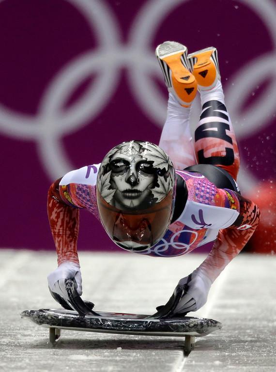 . Sarah Reid of Canada starts her final run during the women\'s skeleton competition at the 2014 Winter Olympics, Friday, Feb. 14, 2014, in Krasnaya Polyana, Russia. (AP Photo/Natacha Pisarenko)