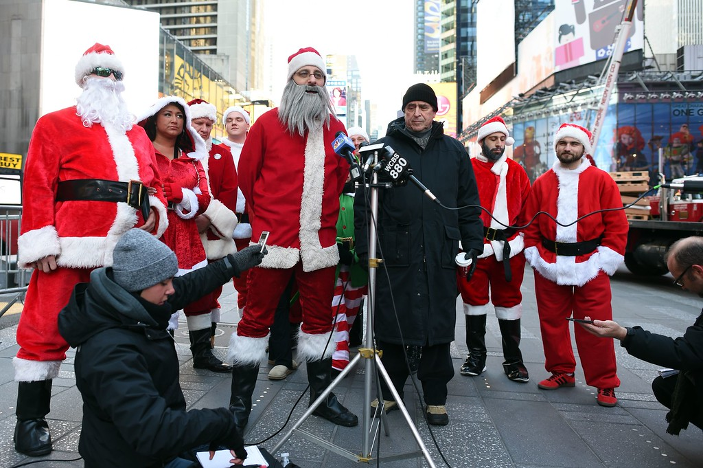 . Santa holds a news conference in Times Square as hundreds of Santas gather for the annual Santacon festivities on December 13, 2014 in New York. AFP PHOTO/DON  EMMERT/AFP/Getty Images