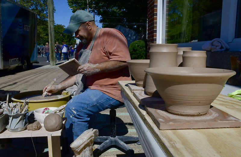 10/5/2019 Mike Orazzi | Staff Robert Riggs demonstrates the art of making pottery while at the 51st Annual Apple Harvest Festival in Southington on Saturday.