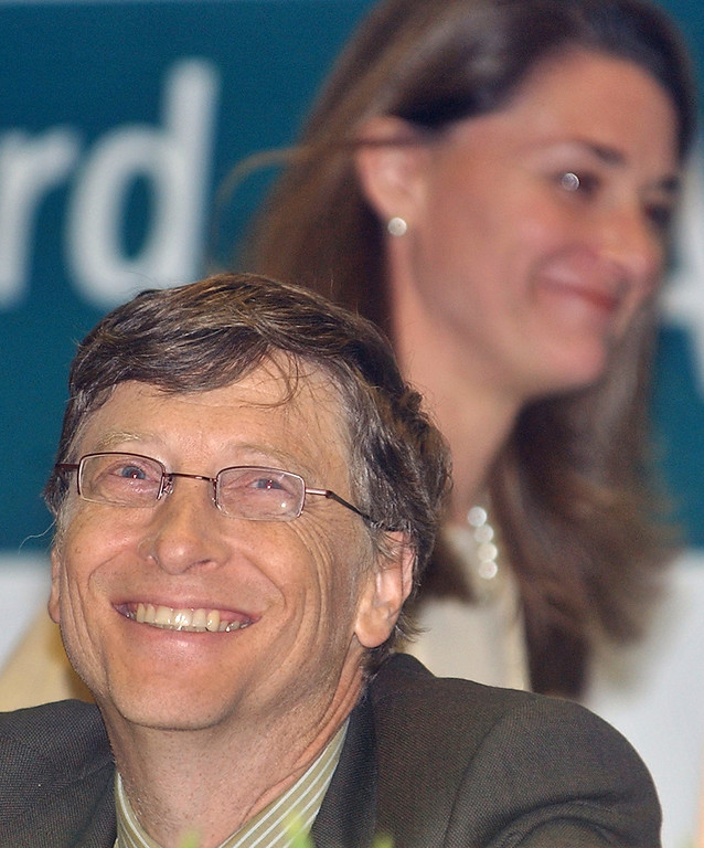 . 2005: The Good Samaritans, represented by Bono, Bill Gates and Melinda Gates. Chairman and founder of Microsoft Corp. Bill Gates smiles as his wife Melinda Gates walks past during the 3rd Partners Meeting of the GAVI Alliance (the Global Alliance for Vaccines and Immunization) in New Delhi, India, Wednesday, Dec. 7, 2005. Gates said Wednesday the U.S. software giant plans to invest US $1.7 billion in India and nearly double its work force in the country over the next four years. (AP Photo/Ajit Kumar)