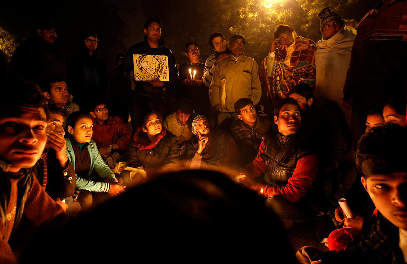 . Indians gather for a candlelight vigil  in memory of a gang-rape victim in New Delhi, India, Thursday, Jan. 3, 2013. A group of men accused of raping a university student for hours on a bus as it drove through Indiaís capital were charged Thursday with murder, rape and other crimes that could bring them the death penalty. The attack on the 23-year-old, who died of severe internal injuries over the weekend, provoked a debate across India about the routine mistreatment of the nationís women and triggered daily protests demanding action. (AP Photo/Tsering Topgyal)