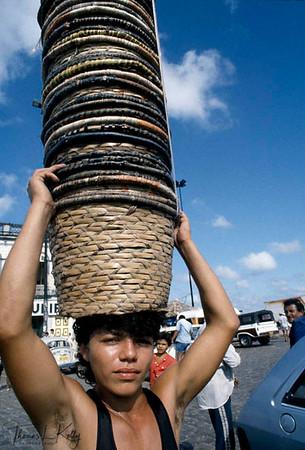 Kayapo tribal man selling hand woven basket in the city area of Brazil for income generationKayapo, Brazilian Amazon.