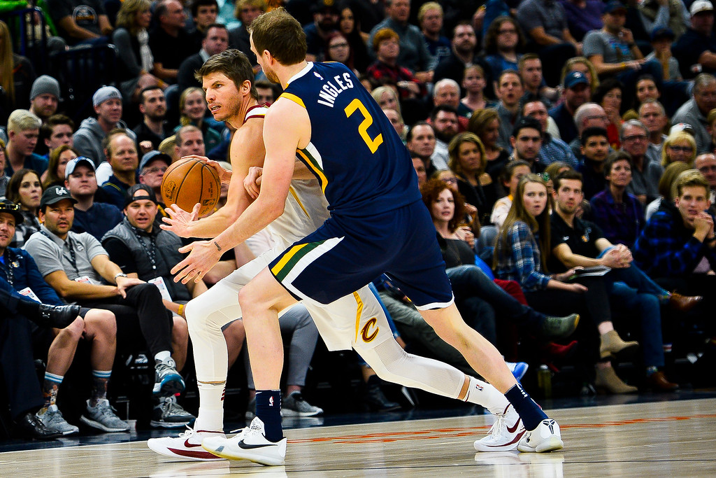 . Cleveland Cavaliers guard Kyle Korver, left, attempts to dribble past Utah Jazz forward Joe Ingles, right, in the first half of an NBA basketball game Saturday, Dec. 30, 2017, in Salt Lake City. (AP Photo/Alex Goodlett)