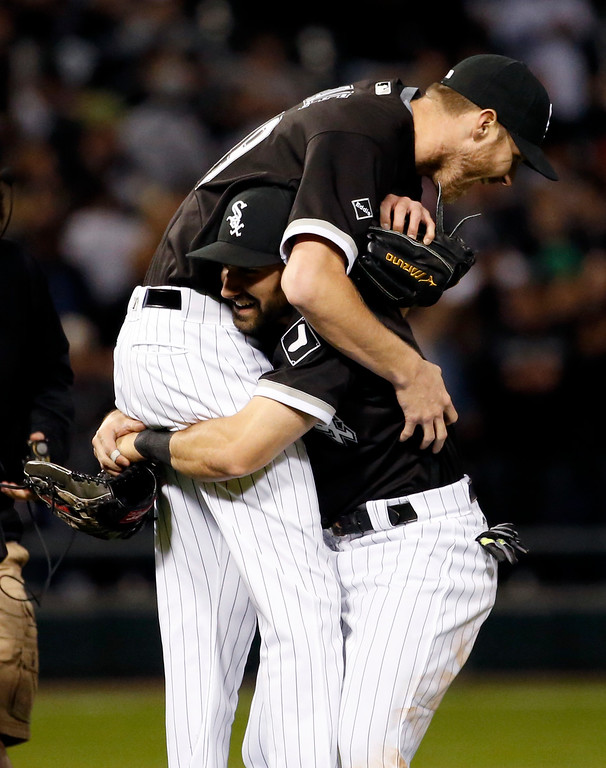 . Chicago White Sox starter Chris Sale, left, celebrates with Adam Eaton after the White Sox defeated the Houston Astros 2-1 in a baseball game Thursday, May 19, 2016, in Chicago. Sale threw a four-hitter. (AP Photo/Nam Y. Huh)