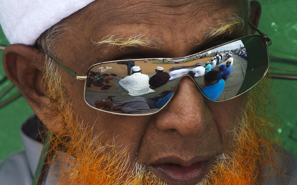 . A Sri Lankan Muslim devote looks on before praying during Eid Al-Adha celebrations at the Galle Face esplanade in Colombo on October 16, 2013. I AFP PHOTO/ LAKRUWAN WANNIARACHCHI/AFP/Getty Images