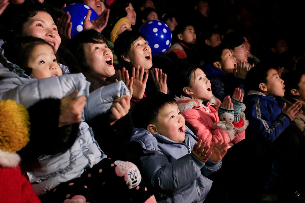 . North Koreans react as they gather to watch a New Year\'s fireworks display at the Kim Il Sung Square in Pyongyang, North Korea, on Sunday, Jan. 1, 2017. (AP Photo/Kim Kwang Hyon)