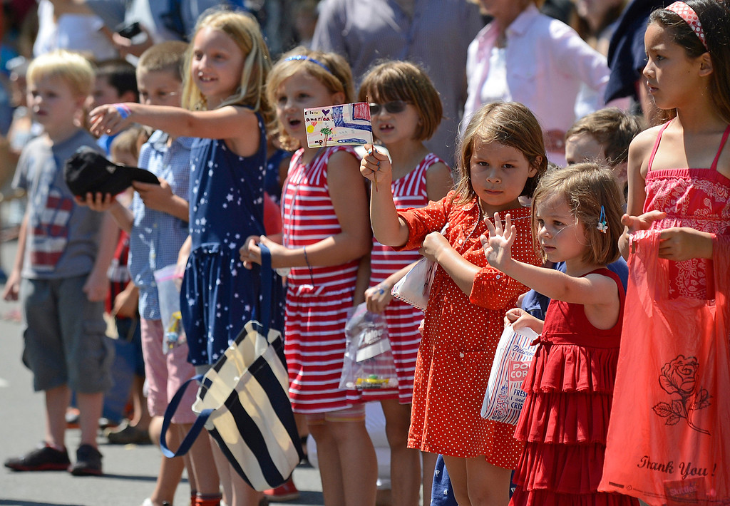 . Children wave at parade participants during Piedmont\'s July 4th parade in Piedmont, Calif., on Thursday, July 4, 2013. (Jose Carlos Fajardo/Bay Area News Group)
