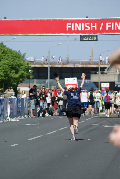 At the finish line!  Her tenth half-marathon in ten different countries!