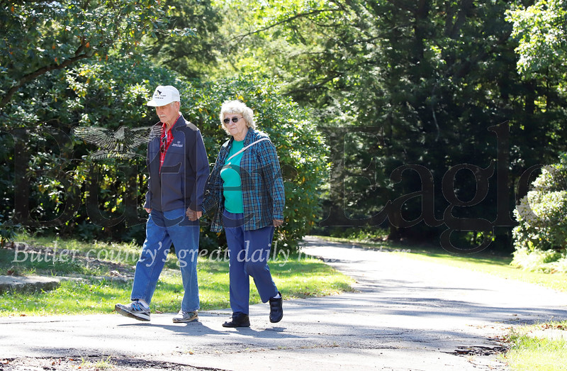 David and Nancy Blewett of Butler enjoy a walk in Preston Park Tuesday. Seb Foltz/Butler Eagle