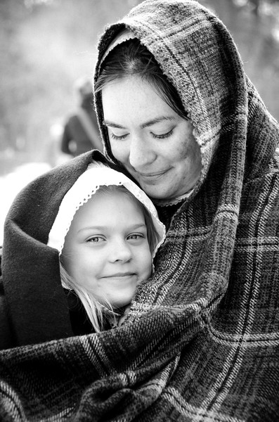 Lots of people in costume during this long weekend for Presidents Day.   I came across this pair and was taken immediately by the connection between the two: a mother's love and a child's comfort in her arms. Powerful. Soothing.