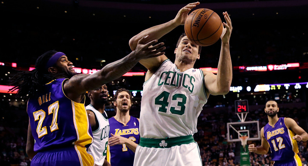 . Boston Celtics forward Kris Humphries (43) grabs a rebound against Los Angeles Lakers center Jordan Hill (27) during the first quarter of an NBA basketball game in Boston, Friday, Jan. 17, 2014. (AP Photo/Charles Krupa)