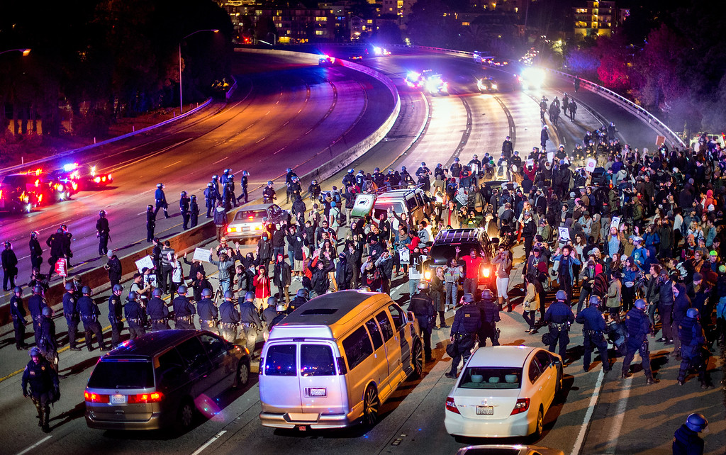 . Protesters block Interstate 580 in Oakland, Calif., on Monday, Nov. 24, 2014,  after the announcement of the grand jury decision not to indict Ferguson police officer Darren Wilson in the fatal shooting of Michael Brown, an unarmed 18-year-old. (AP Photo/Noah Berger)