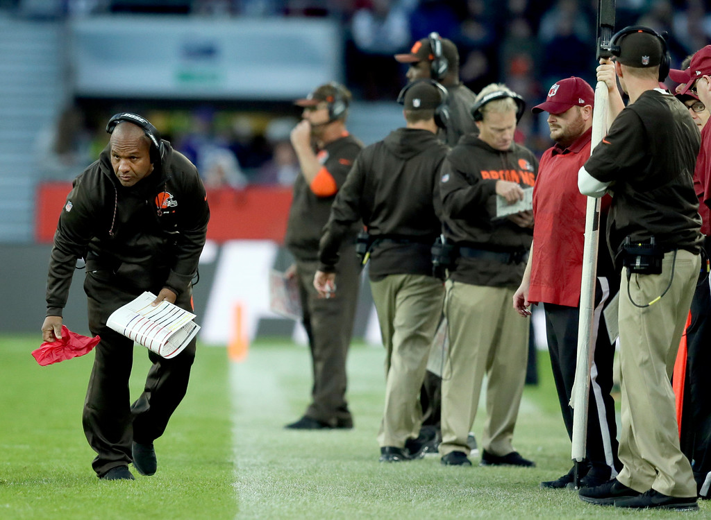 . Cleveland Browns head coach Hue Jackson holds a challenge flag on the sideline during the second half of an NFL football game against Minnesota Vikings at Twickenham Stadium in London, Sunday Oct. 29, 2017. (AP Photo/Tim Ireland)