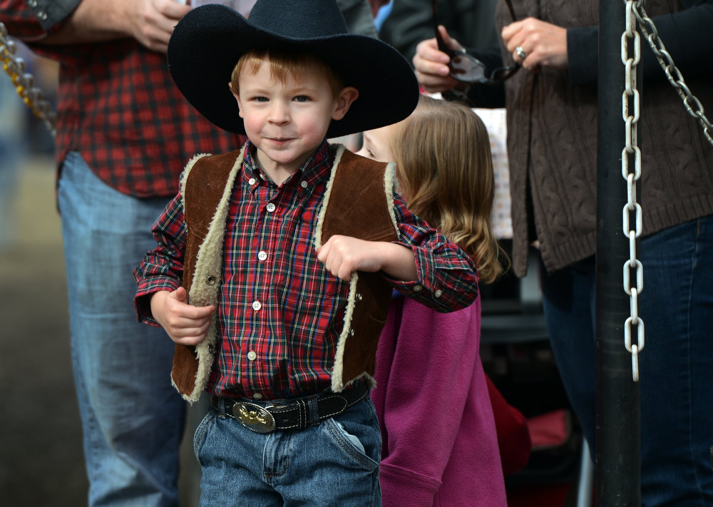 """. Samuel Fatovic, 4, arrive with his family at the National Western Stock Show in Denver, CO, January, 26, 2013. His mother Lisa said, \""""he loves being a cowboy.\""""  (Photo By Craig F. Walker / The Denver Post)"""