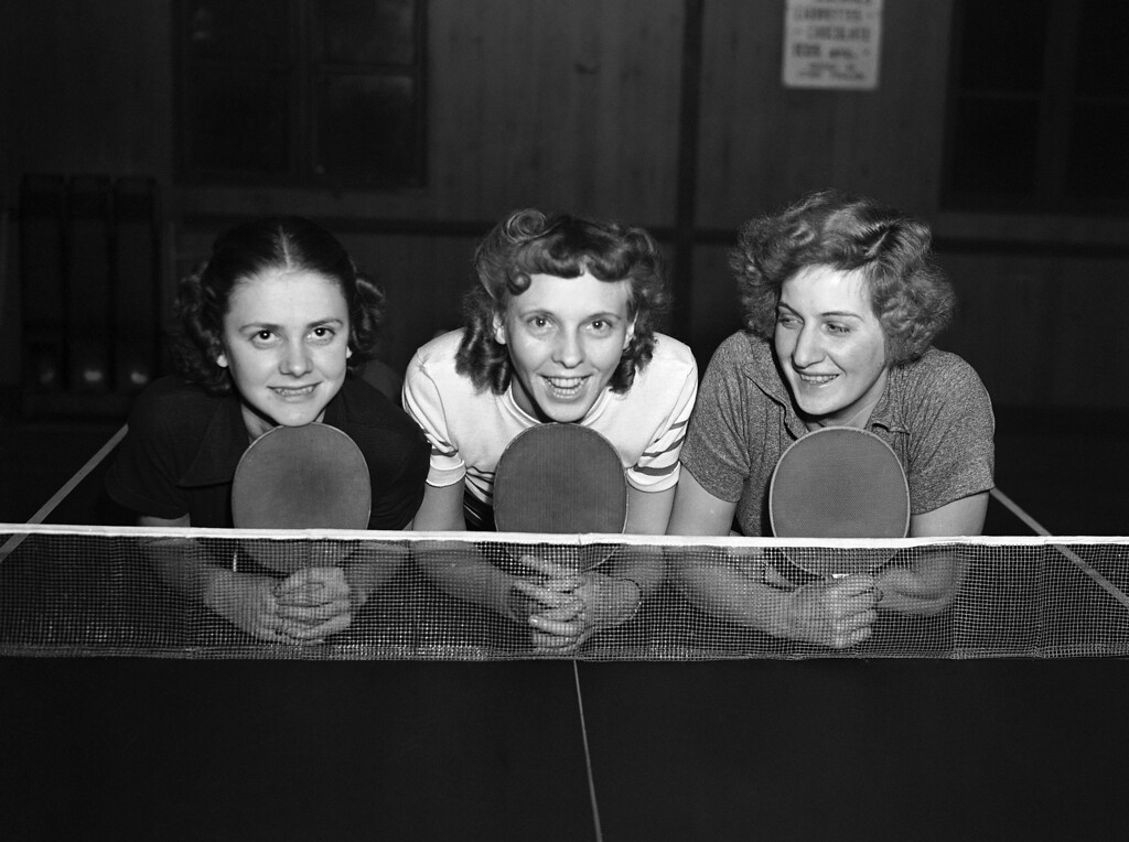 . Betty Henry, left, Mildred Wilkinson and Clara Harrison, right, three members of the U.S.A. table tennis team, at the Bradix Club, in Ealing, in London, on Jan. 20, 1938, when they started preparations for the World Championships. (AP Photo)