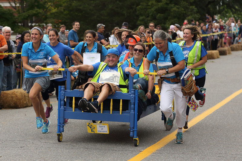 From left:  Ali Wicks, Gretchen Gibbs, Marisa Khurana, Scott Mulcahy, Lauren Carchidi, Josh Myler, Mandy Ostaszewski, Allison Thornton, and Amy Bassage charge toward the finish line in the Lions Club Volkfest bed races in the Bromfield School driveway, Sept. 8. Initially in two teams, old school and new school, the teams combined when asked to do a runoff, proving the power of cooperation. Spirit of Harvard, indeed!  (Photo by Lisa Aciukewiz)