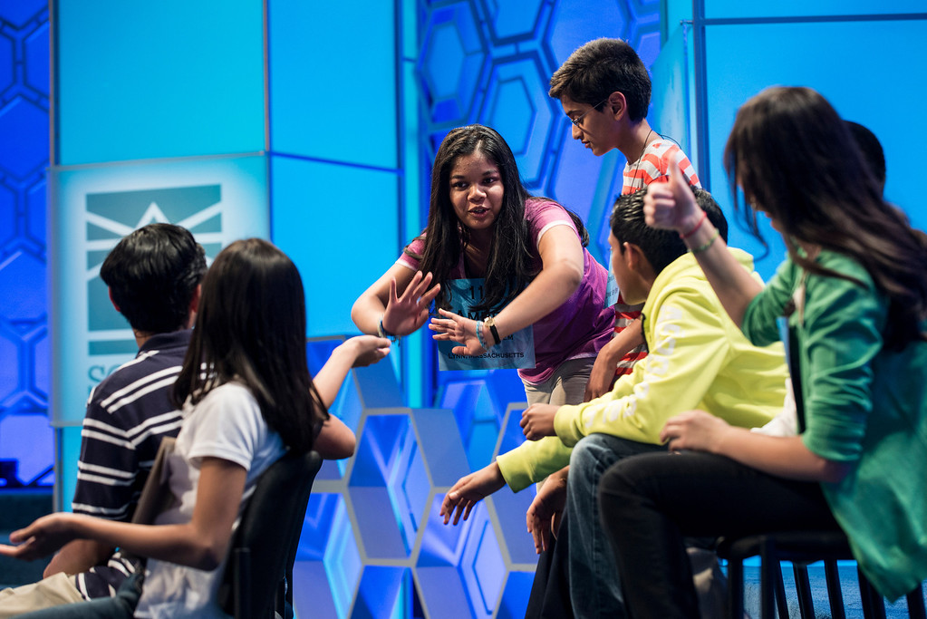 . Amber Born, representing Massachusetts, is cheered on by her competitors during the championship round at the Scripps National Spelling Bee May 30, 2013 in National Harbor, Maryland.  BRENDAN SMIALOWSKI/AFP/Getty Images