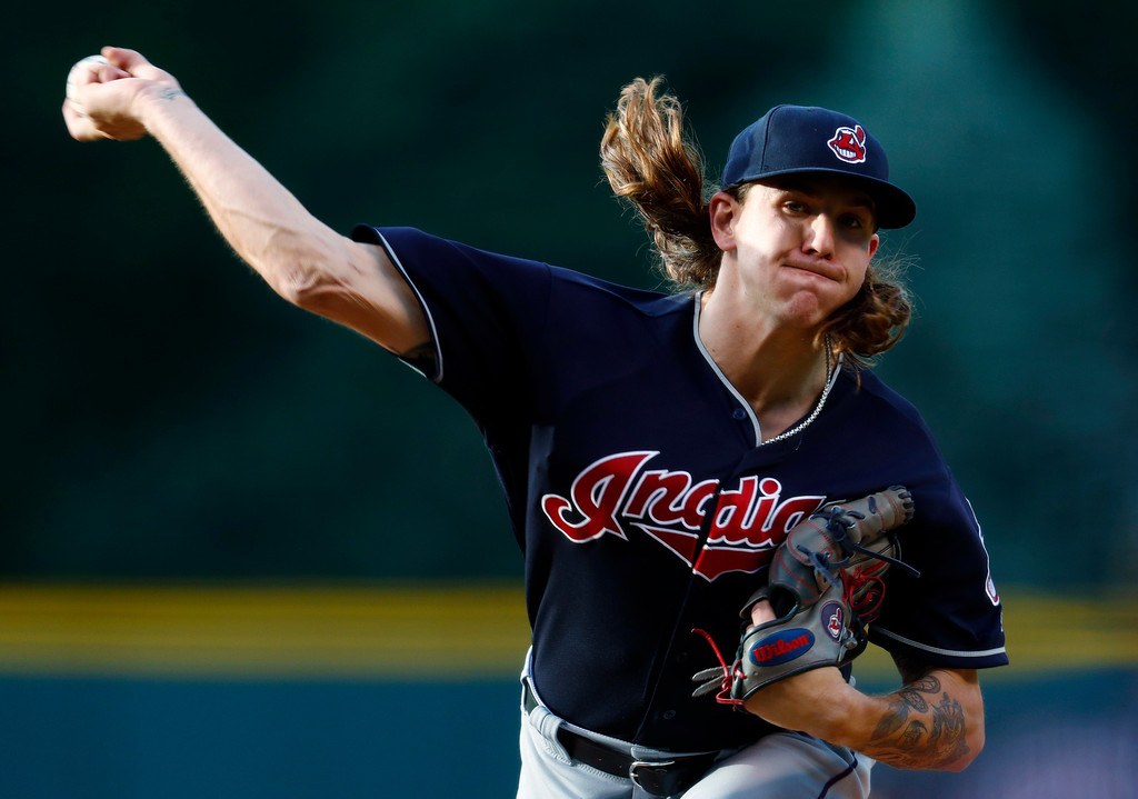 . Cleveland Indians starting pitcher Mike Clevinger delivers a pitch to Colorado Rockies\' Charlie Blackmon in the first inning of an interleague baseball game Tuesday, June 6, 2017, in Denver.(AP Photo/David Zalubowski)